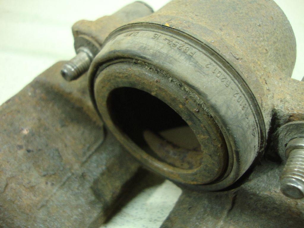 Суппорт тормозной передний левый 1K0615123E