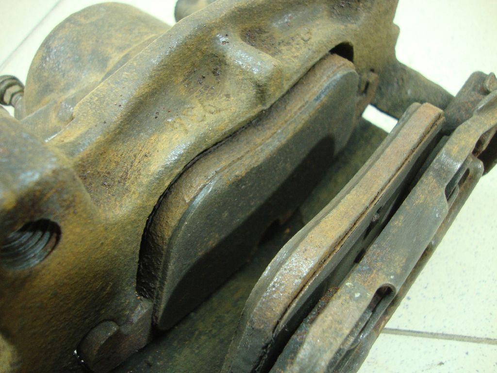 Суппорт тормозной передний левый 1583140