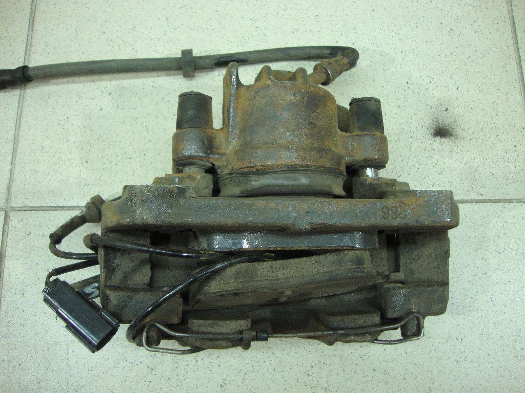 Суппорт тормозной передний правый 9475270