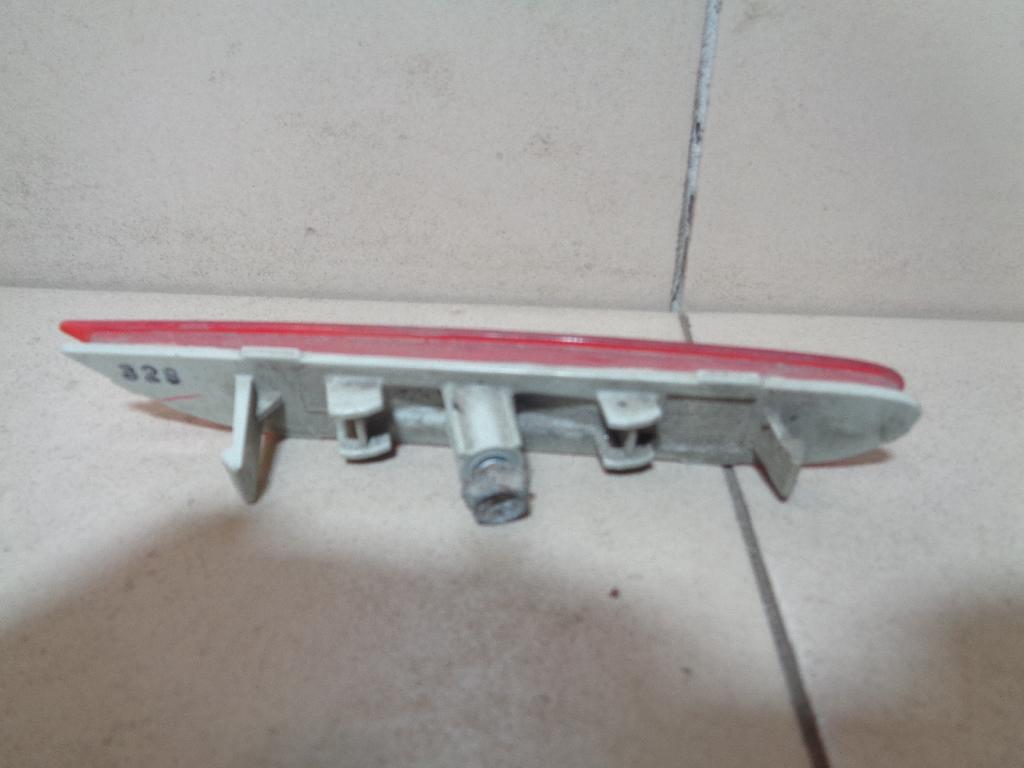 Отражатель в бампер задний левый 26565JJ90A