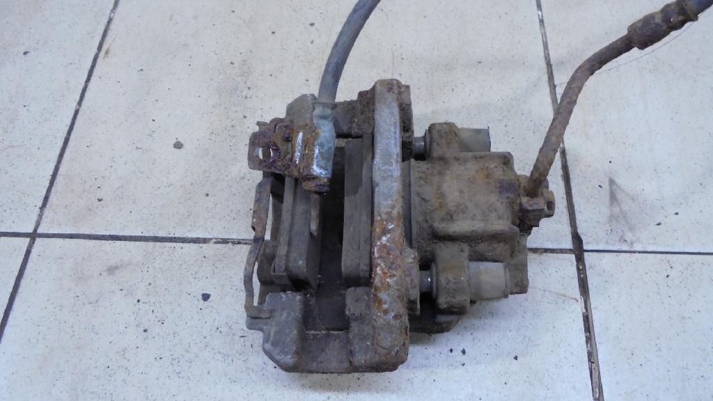 Суппорт тормозной задний правый 6L1Z2552AA