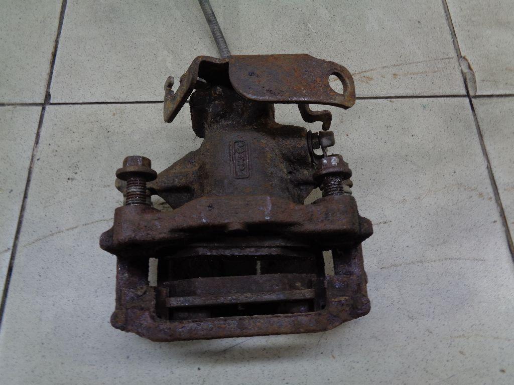 Суппорт тормозной задний левый 1521636