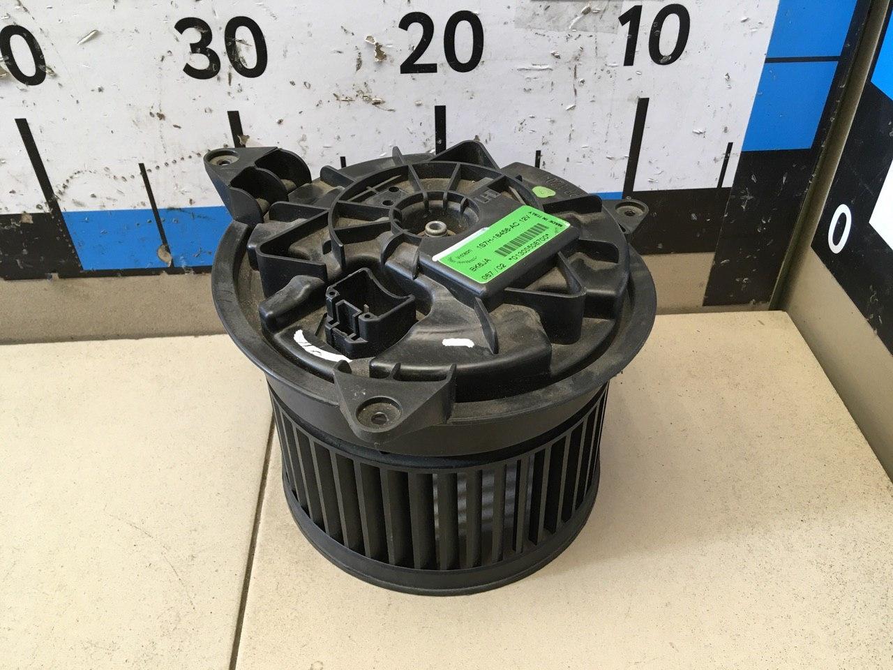 Моторчик отопителя 1S7H18456AC