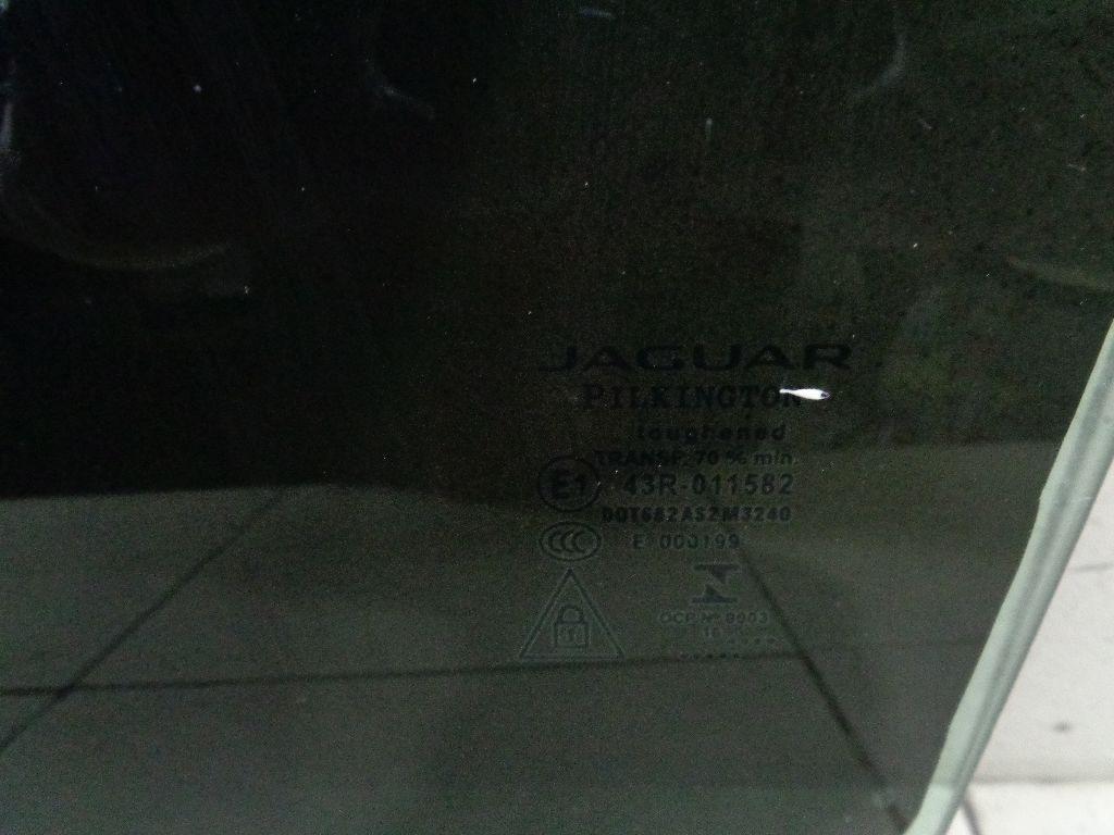 Стекло двери задней левой T4A1200
