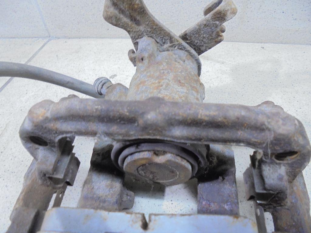 Суппорт тормозной задний правый 13300862
