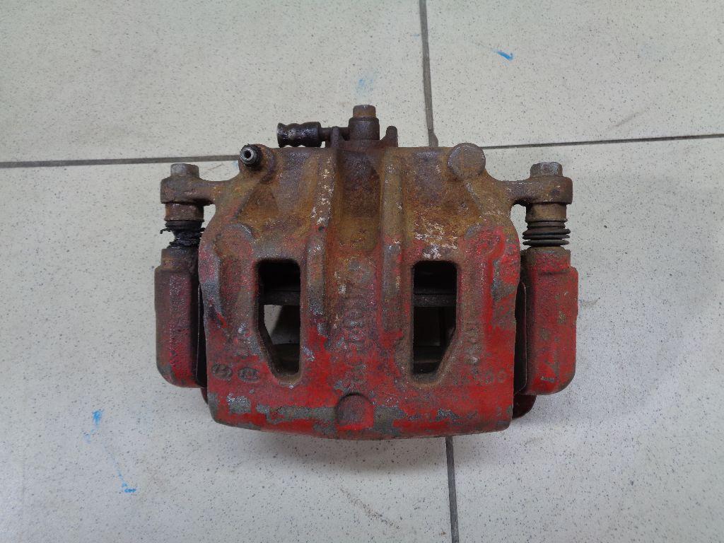 Суппорт тормозной передний левый 581102W700