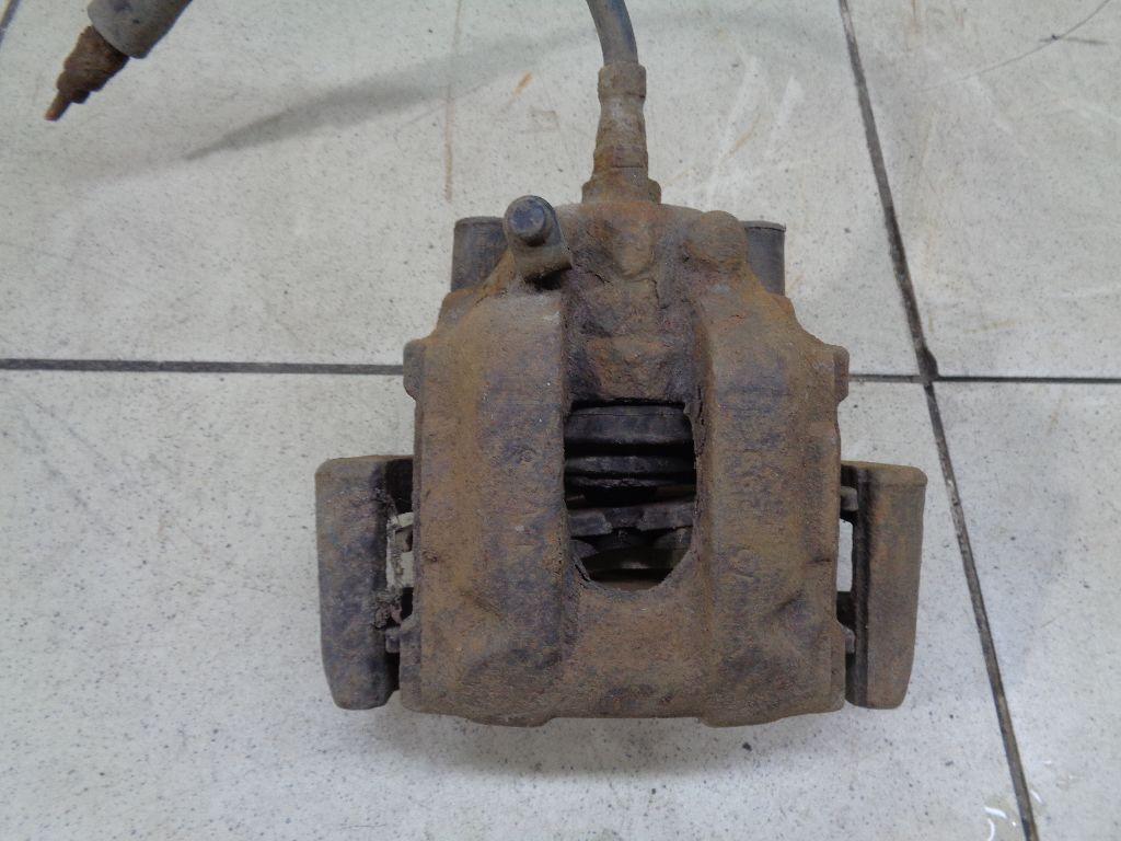 Суппорт тормозной задний левый 34211164579